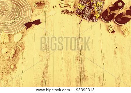 Sand and shells and hat on the wooden floor of the yelow, summer concept, travel Seychely, beach Florida, Hawai, swimm in Bali, summer pradise