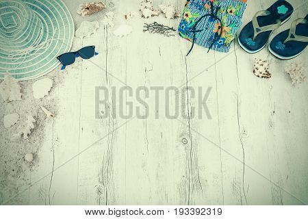 Sand and shells and hat on the wooden floor, summer concept, travel Seychely, beach Florida, Hawai, swimm in Bali, summer pradise