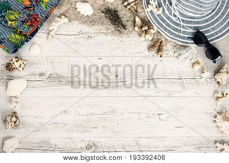 Sand and shells and hat on the wooden floor summer concept travel Seychely beach Florida Hawai swimm in Bali summer pradise