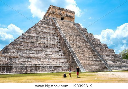 Chichen Itza Mexico - April 18 2016: Archaeological site tousists under the imposing Castle ( El Castillio)