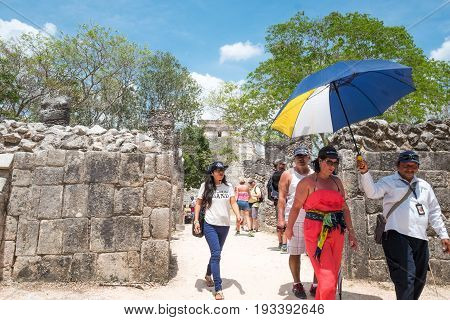 Chichen Itza Mexico - April 18 2016: Tourists in the archaeological site