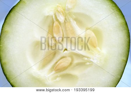 Closeup Of Cucumber Cross Section With Detail Of Crisp Juicy Seeds And Flesh Of Vegetable