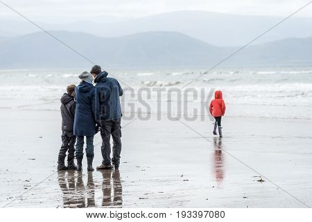 Family Confers At Inch Beach