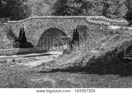 Stone Bridge With Footpath Over A River