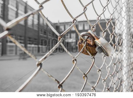 Rusty Padlock And Combination Lock Attached To Chain Link Fence