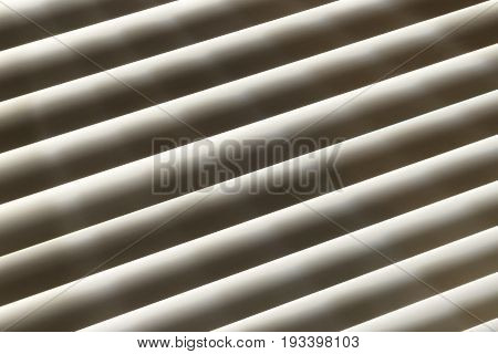 Soft beams of light filtering through window blinds rays shining through slats