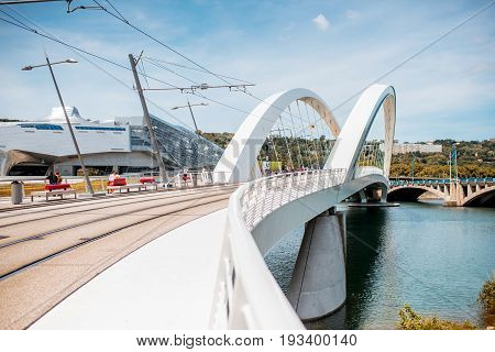 LYON, FRANCE - May 21, 2017: View on Raymond Barre bridge and modern Confluences museum in Lyon