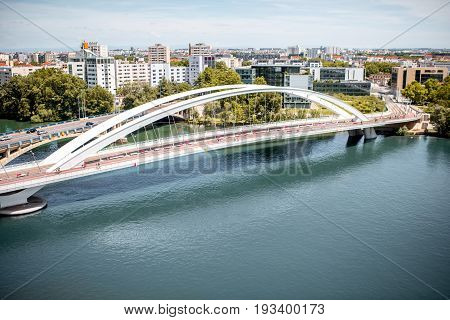 Top view on Rhone river and modern district with Raymond Barre bridge in Lyon city
