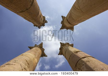 Jerash in jordan Columns and airplane in the middle