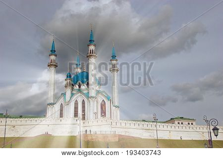 Beautiful City Mosque In The Rays On A Background Of Clouds