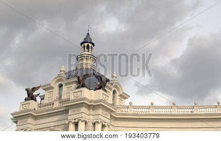 Beautiful Old Building With Gargoyles On A Background Of Dark Sky With Storm Clouds
