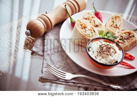 hot spicy armenian shawarma on white plate
