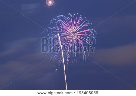 Holiday colorful fireworks background in horizontal frame