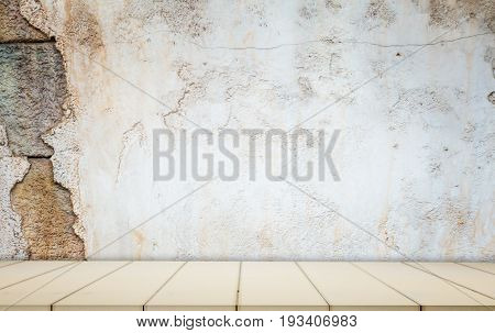 Whtie wooden counter with cracked concrete wall