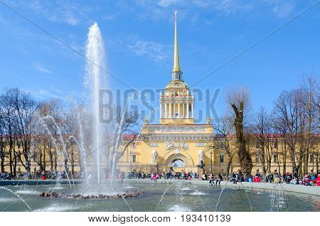 SAINT PETERSBURG RUSSIA - MAY 1 2017: Unknown tourists are at fountain near Main Admiralty Building on Admiralty passage St. Petersburg Russia