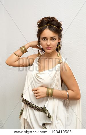 beautiful greek young woman in white ancient tunic