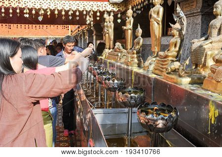 Chiang Mai Thailand - 8 January 2016: belivers praying at the Wat Phra That Doi Suthep temple of Chiang Mai Thailand