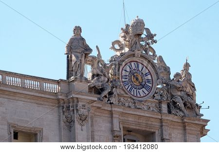 ROME, ITALY - SEPTEMBER 02: One of the giant clocks on the St. Peter's facade. Two clocks were added in 1786-1790 by Giuseppe Valadier. Basilica of St. Peter in Vatican, Rome, on September 02, 2016.