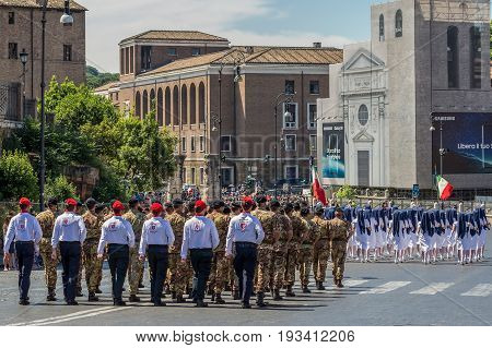 ROME ITALY - JUNE 2 2017: Military parade at Italian National Day. Nurses soldiers and representatives of the Malta Order with flags in formation. Between Piazza Venezia and Teatro di Marcello.
