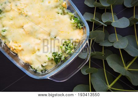 casserole with broccoli, cheese and cream, close-up