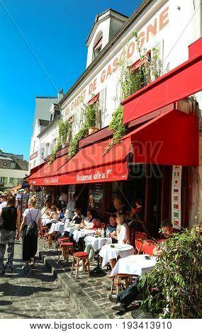 PARIS , France- June 01, 2017: View of typical cafe Au Cadet de Gascognelocated in Montmartre area , one of among most popular destinations in Paris, Au clairon de chasseur is a typical cafe.