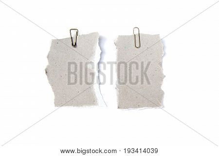 collection of white ripped pieces of paper with paper clip isolated on white background. each one is shot separately