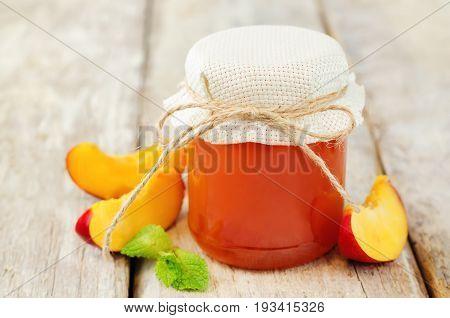 Peach jam with mint and fresh peach slices