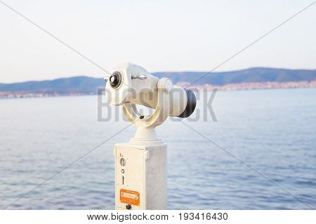 Telescope on the sea-summer, sun, sea beach