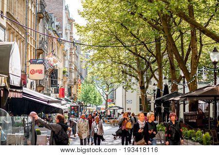LUXEMBOURG, LUXEMBOURG - May 18, 2017: View on the crowded Armes square with shops and restaurants in Luxembourg city