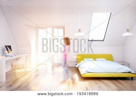 Woman in a white attic bedroom with a wooden floor a narrow window a yellow bed and a white table with a computer. 3d rendering mock up toned image
