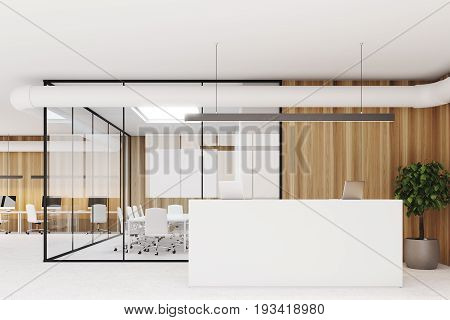 Wooden wall office interior with a concrete floor glass walls a tree in a pot a meeting room and a white reception counter with laptops on it. 3d rendering mock up