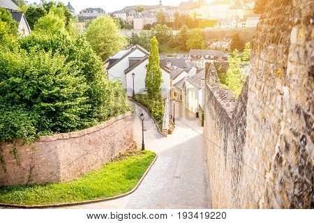 Street view near the castle wall in the old town of Luxembourg during the sunset