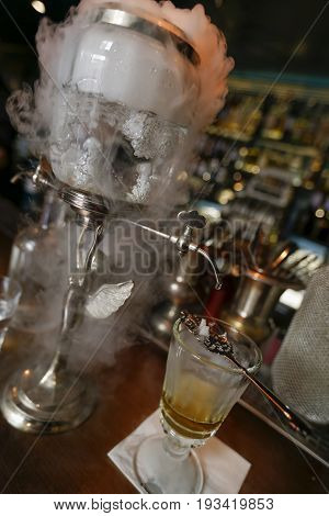Prague Czech Republic - June 02 2017 - preparation of traditional absinthe in bar on old town of prague poster