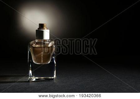 Perfume bottle on dark background