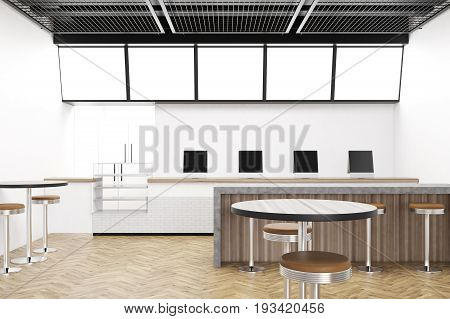 Modern cafe interior with round tables and chairs. Tablet computers on a counter. Marble and wooden bar stand a row of stools. Black ceiling. 3d rendering mock up