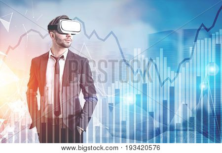 Front view of a bearded man wearing a suit and VR glasses and standing against a blue cityscape with graphs in the air. Toned image double exposure mock up