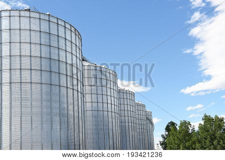 WALL, SOUTH DAKOTA - JUNE 22, 2017: Silos against a blue cloudy sky in the midwest town of Wall, South Dakota.