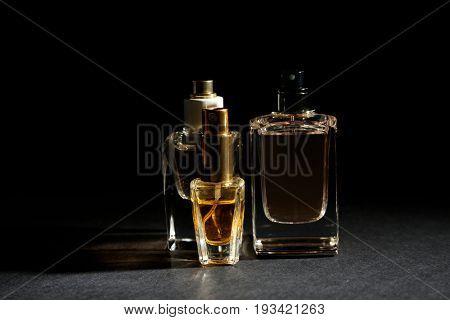 Perfume bottles on dark background