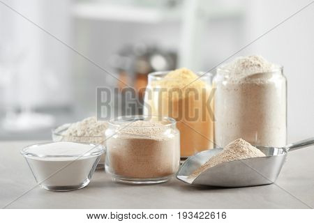 Composition with different types of flour on table