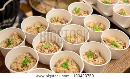 Brown Rice Is Divided Into Portions Close-up. Macrobiotics And Healthy Nutrition.