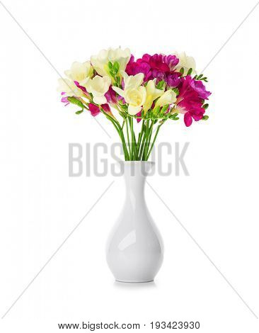 Bouquet of beautiful freesia in vase on white background