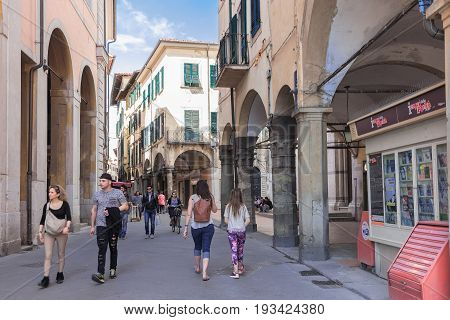 isa, Italy - April 07, 2017: Tourists on the street in Pisa