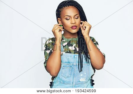 African-american Woman In Casual Clothes Touching Ears