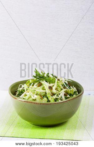Coleslaw Cabbage Salad with Pumpkin Seeds. Selective focus.