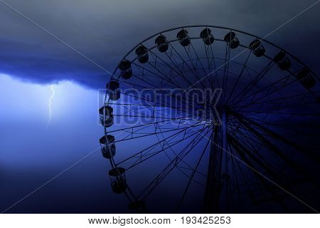 Funfair wheel in Bournemouth on a stormy day