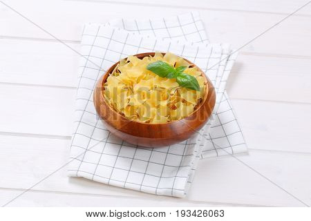 bowl of quadretti - square shaped pasta on checkered dishtowel