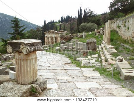 The sacred way leading to the Treasury of the Athenians in Archaeological Site of Delphi, Greece