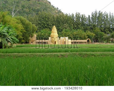 Model of Khmer Temple Made from Loincloth on Vibrant Green Paddy Field, Nakhon Ratchasima province, Thailand