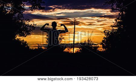 Build muscle bodybuilder on a sunset colorful background