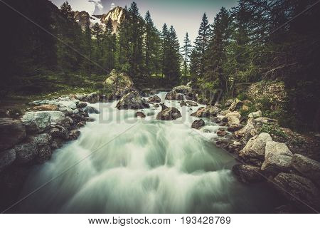 Alpine River and Waterfall Scenery in Entreves Ferret Valley Italy.